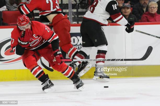 Carolina Hurricanes Defenceman Justin Faulk gets hit in the face during the 2nd period of the Carolina Hurricanes game versus the Arizona Coyotes on...