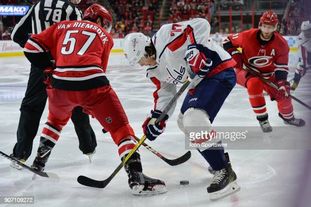 Carolina Hurricanes Defenceman Trevor van Riemsdyk and Washington Capitals Right Wing TJ Oshie battle for a loose puck during a game between the...
