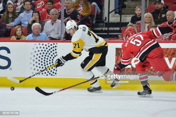 Carolina Hurricanes Defenceman Trevor van Riemsdyk chases after Pittsburgh Penguins Center Evgeni Malkin during a game between the Pittsburgh...