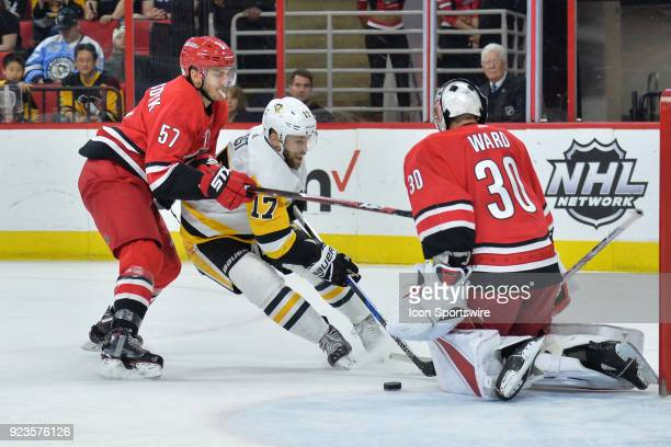 Carolina Hurricanes Defenceman Trevor van Riemsdyk pressures Pittsburgh Penguins Right Wing Bryan Rust as he skates with the puck into Carolina...