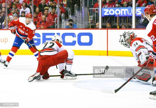 Carolina Hurricanes defenseman Brett Pesce and Carolina Hurricanes goaltender Petr Mrazek combine to stop the second period shot of Washington...