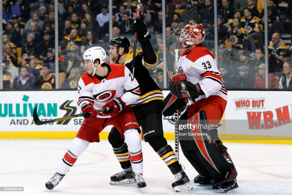 Carolina Hurricanes defenseman Brett Pesce (22) tries to fend off Boston Bruins right wing Rick Nash (61) in front of Carolina Hurricanes goalie Scott Darling (33) during a game between the Boston Bruins and the Carolina Hurricanes on February 27, 2018, at TD Garden in Boston, Massachusetts. The Bruins defeated the Hurricanes 4-3 (OT).