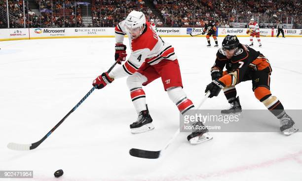 Carolina Hurricanes defenseman Haydn Fleury keeps the puck away from Anaheim Ducks leftwing Andrew Cogliano in the first period of a game played on...