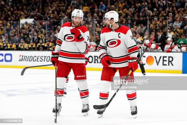 Carolina Hurricanes defenseman Jaccob Slavin and Carolina Hurricanes right wing Justin Williams discuss a face off during Game 2 of the Stanley Cup...