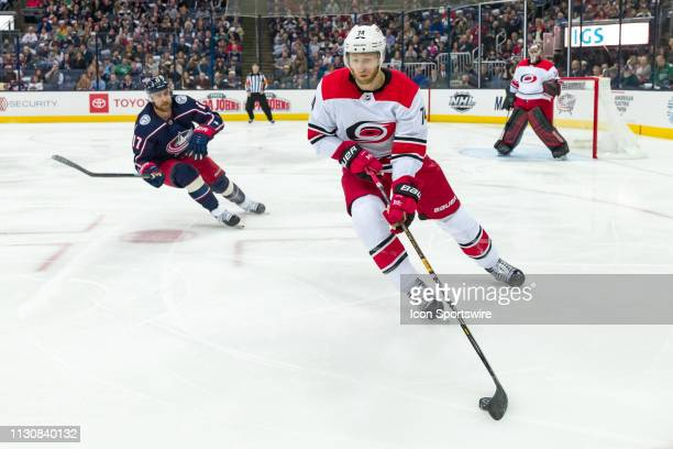 Carolina Hurricanes defenseman Jaccob Slavin clears the puck in a game between the Columbus Blue Jackets and the Carolina Hurricanes on March 15 2019...