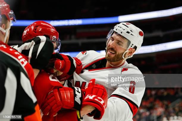 Carolina Hurricanes defenseman Joel Edmundson tussles with Detroit Red Wings defenseman Gustav Lindstrom of Sweden during a regular season NHL hockey...