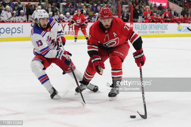 Carolina Hurricanes defenseman Justin Faulk with the puck with New York Rangers center Mika Zibanejad behind him during the 3rd period of the...