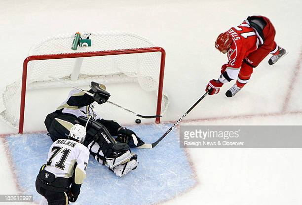 Carolina Hurricanes' Eric Staal puts this shot past Pittsburgh Penguins goalie Brent Johnson and Evgeni Malkin for what proved to be the gamewinner...
