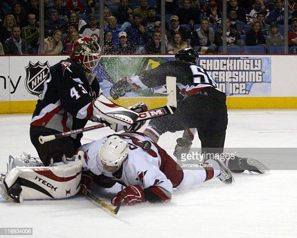 Carolina Hurricanes' Erik Cole is awarded a penalty shot after being taken down by Buffalos' Jochen Hecht during a game against the Buffalo Sabres at...