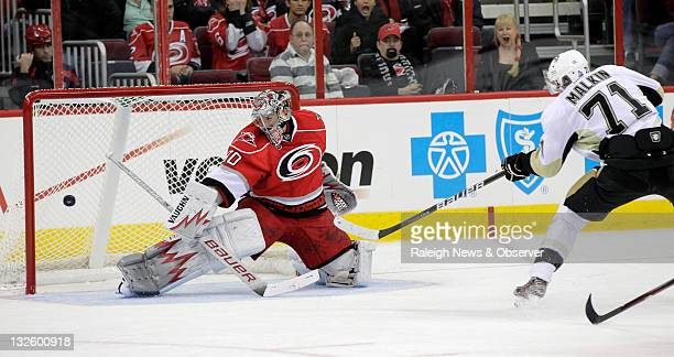 Carolina Hurricanes goalie Cam Ward blocks a shot by the Pittsburgh Penguins' Evgeni Malkin during the first period at the RBC Center in Raleigh...