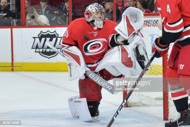 Carolina Hurricanes Goalie Cam Ward makes a save during a game between the Pittsburgh Penguins and the Carolina Hurricanes at the PNC Arena in...