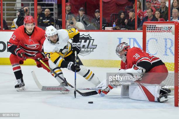 Carolina Hurricanes Goalie Cam Ward makes a save on a shot by Pittsburgh Penguins Right Wing Bryan Rust during a game between the Pittsburgh Penguins...