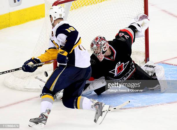 Carolina Hurricanes' goalie Cam Ward stops the final shot of the shoot out by Buffalo Sabres' Tim Connolly at the RBC Center in Raleigh North...
