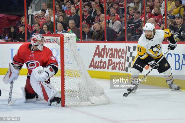 Carolina Hurricanes Goalie Cam Ward watches Pittsburgh Penguins Center Sidney Crosby during a game between the Pittsburgh Penguins and the Carolina...