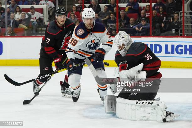 Carolina Hurricanes Goalie Curtis McElhinney makes a save in front of Edmonton Oilers Right Wing Alex Chiasson during a game between the Edmonton...