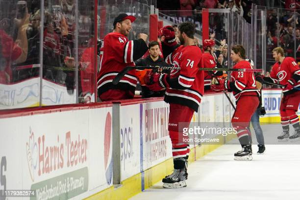 Carolina Hurricanes Goalie James Reimer hands out candy to Carolina Hurricanes Defenceman Jaccob Slavin during the Storm Surge celebration during a...