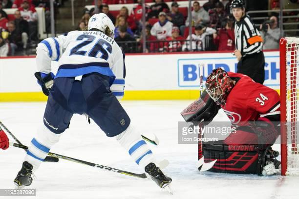 Carolina Hurricanes Goalie Petr Mrazek makes a save on a shot by Winnipeg Jets Center Blake Wheeler during a game between the Carolina Hurricanes and...