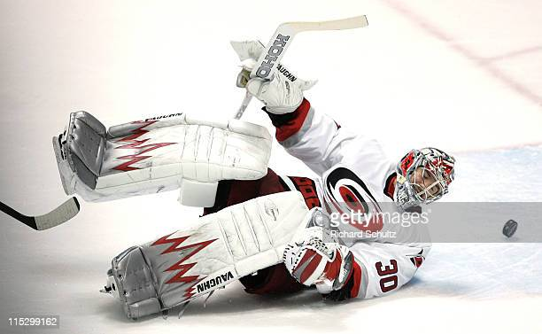 Carolina Hurricanes' goaltender Cam Ward watches as the puck off the stick of New Jersey Devils' Jay Pandolfo goes past him into the net for a goal...