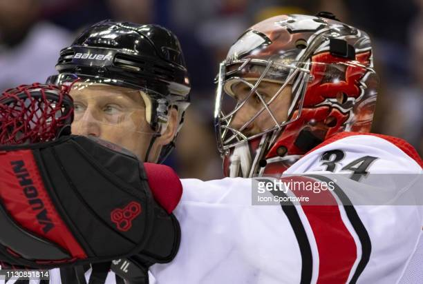 Carolina Hurricanes goaltender Petr Mrazek discusses a play with a referee during a timeout in a game between the Columbus Blue Jackets and the...