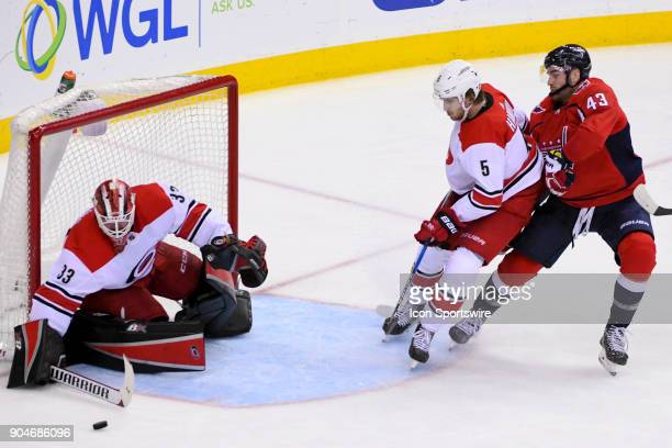 Carolina Hurricanes goaltender Scott Darling and defenseman Noah Hanifin in action against Washington Capitals right wing Tom Wilson on January 11 at...