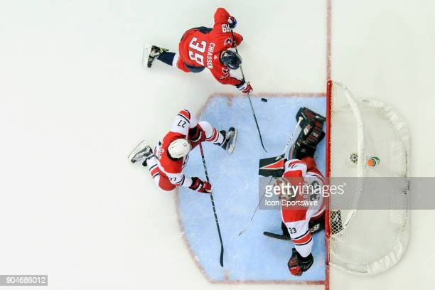 Carolina Hurricanes goaltender Scott Darling makes a first period save on a shot by Washington Capitals right wing Alex Chiasson on January 11 at the...