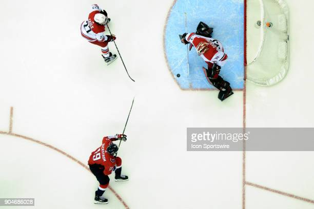 Carolina Hurricanes goaltender Scott Darling makes a save against Washington Capitals center Nicklas Backstrom on January 11 at the Capital One Arena...
