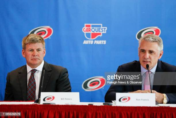Carolina Hurricanes head coach Bill Peters left and general manager Ron Francis speak to the media during Peters' introductory news conference at PNC...
