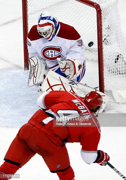 Carolina Hurricanes' Jamie McBain scores his second goal against the Montreal Canadiens Alex Auld during the third period of an NHL game at the RBC...