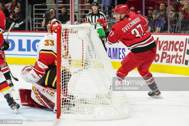 Carolina Hurricanes Left Wing Andrei Svechnikov scores a lacrosse style goal during a game between the Calgary Flames and the Carolina Hurricanes at...