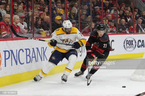 Carolina Hurricanes left wing Brock McGinn and Nashville Predators defenseman PK Subban stare down the puck during the 1st period of the Carolina...