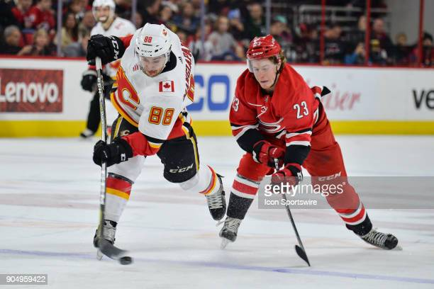Carolina Hurricanes Left Wing Brock McGinn defends Calgary Flames Left Wing Andrew Mangiapane on a shot attempt from the blue line during a game...