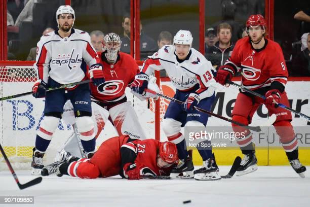 Carolina Hurricanes Left Wing Brock McGinn is knocked to the ice by Washington Capitals Defenceman Matt Niskanen in front of Carolina Hurricanes...
