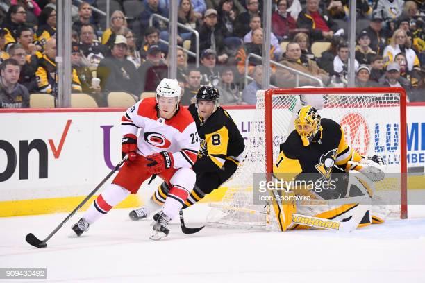 Carolina Hurricanes Left Wing Brock McGinn skates the puck around the net behind Pittsburgh Penguins Goalie Casey DeSmith as Pittsburgh Penguins...