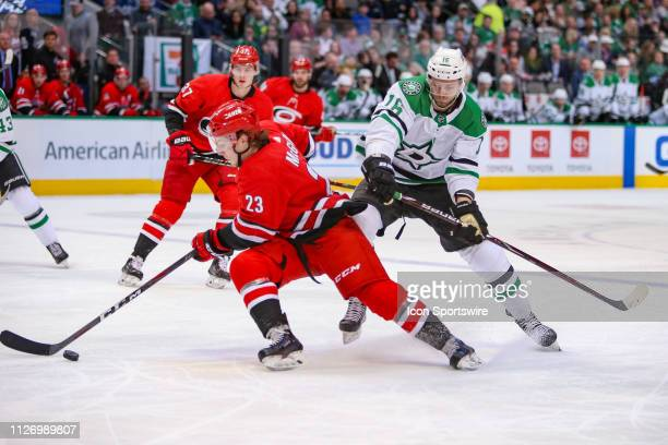 Carolina Hurricanes left wing Brock McGinn stick handles the puck with Dallas Stars center Jason Dickinson attacking during the game between the...