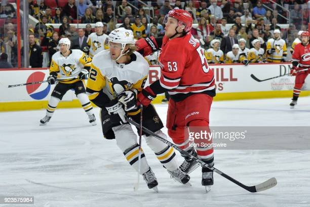 Carolina Hurricanes Left Wing Jeff Skinner and Pittsburgh Penguins Left Wing Carl Hagelin collide during a game between the Pittsburgh Penguins and...