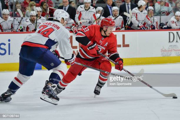 Carolina Hurricanes Left Wing Jeff Skinner skates with the puck in front of Washington Capitals Defenceman John Carlson during a game between the...