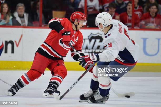 Carolina Hurricanes Left Wing Jeff Skinner skates with the puck around Washington Capitals Defenceman Dmitry Orlov during a game between the...
