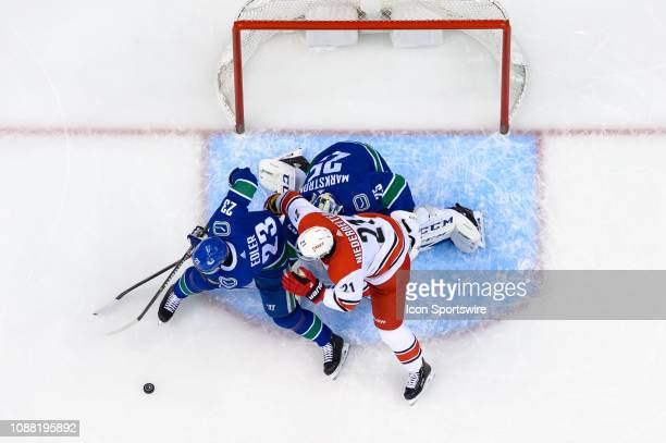 Carolina Hurricanes Left Wing Nino Niederreiter battles for the puck with Vancouver Canucks Defenseman Alexander Edler in front of Goaltender Jacob...