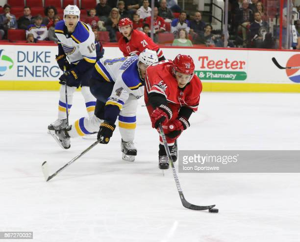 Carolina Hurricanes Left Wing Sebastian Aho reaches for the puck during the 1st period of the Carolina Hurricanes game versus the St Louis Blues on...