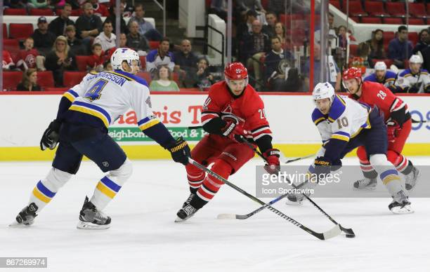 Carolina Hurricanes Left Wing Sebastian Aho with the puck while St Louis Blues Defenceman Carl Gunnarsson tries to steal it during the 1st period of...