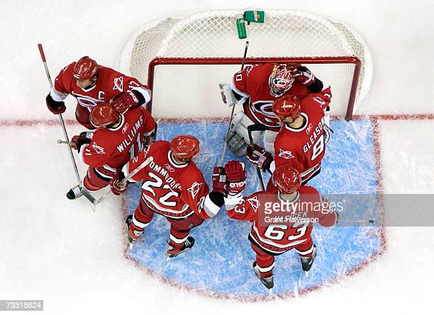 Carolina Hurricanes players celebrate after a win over the Los Angeles Kings on February 13, 2007 at the RBC Center in Raleigh, North Carolina. The...