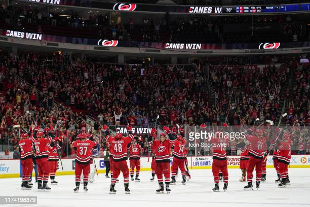 Carolina Hurricanes players celebrate the Storm Surge after winning the game between the Tampa Bay Lightning and the Carolina Hurricanes at the PNC...