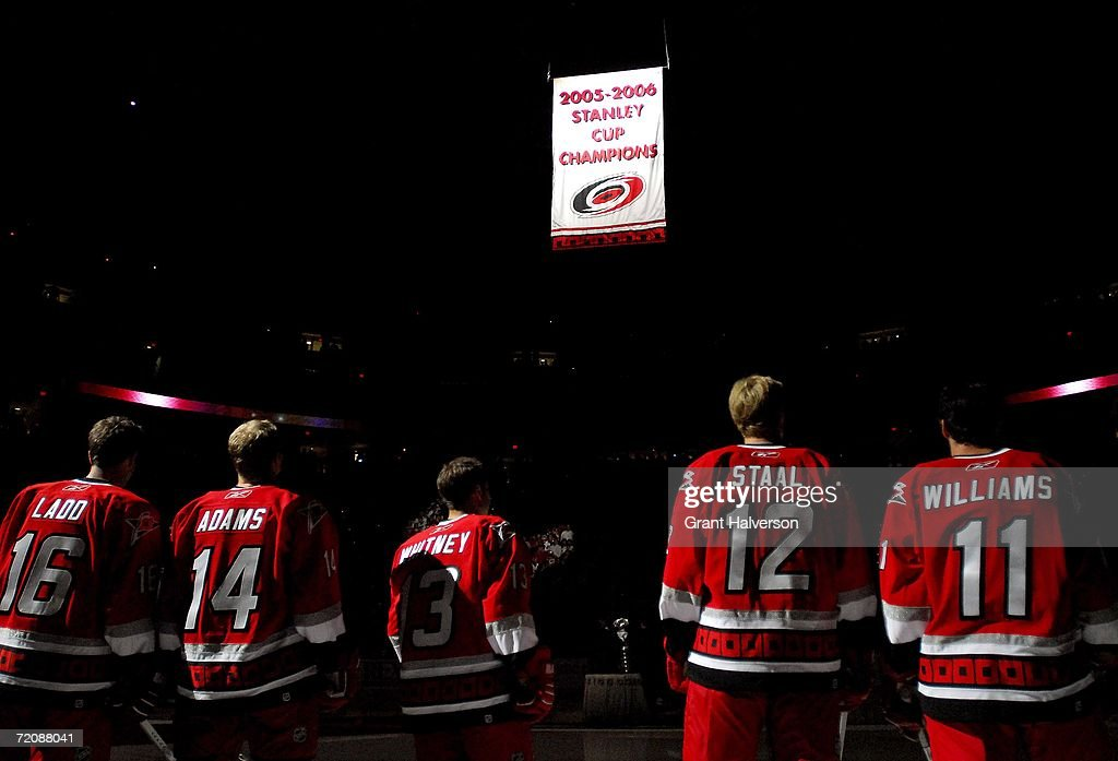 Carolina Hurricanes players watch as the 2005-2006 Stanley Cup banner is raised before their NHL game against the Buffalo Sabres on October 4, 2006, at the RBC Center in Raleigh, North Carolina.