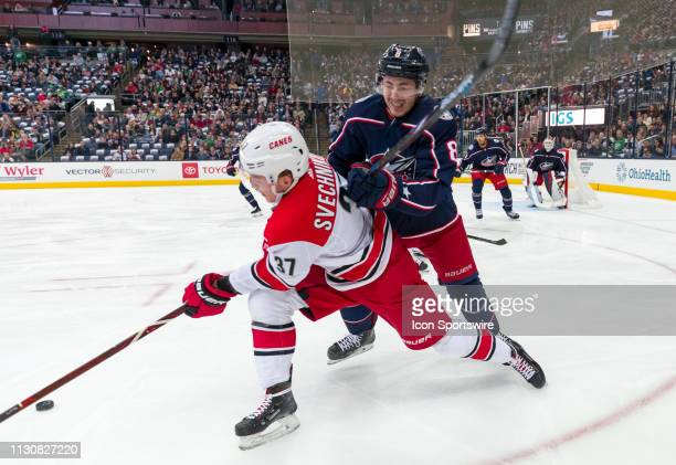 Carolina Hurricanes right wing Andrei Svechnikov battles with Columbus Blue Jackets defenseman Zach Werenski in a game between the Columbus Blue...
