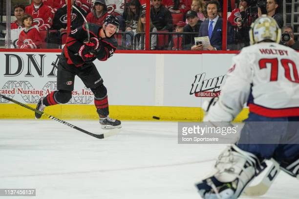 Carolina Hurricanes right wing Andrei Svechnikov shoots the puck on Washington Capitals goaltender Braden Holtby during a game between the Carolina...