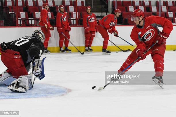 Carolina Hurricanes Right Wing Julien Gauthier skates with puck in front of Carolina Hurricanes Goalie Callum Booth during the Carolina Hurricanes...
