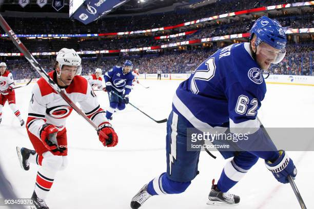 Carolina Hurricanes right wing Justin Williams and Tampa Bay Lightning defenseman Andrej Sustr in action in the first period of the NHL game between...