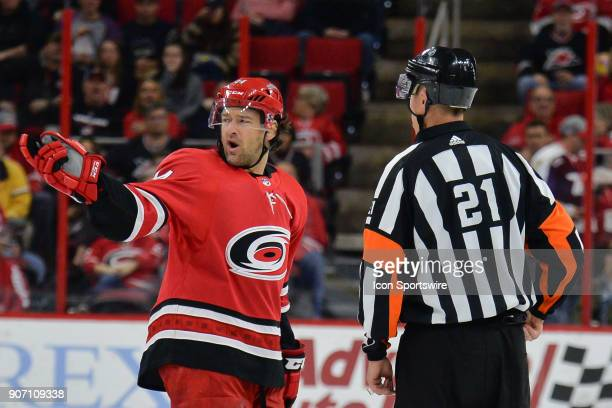 Carolina Hurricanes Right Wing Justin Williams argues a call on the ice with NHL referee TJ Luxmore during a game between the Washington Capitals and...