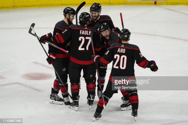 Carolina Hurricanes right wing Justin Williams celebrates with teammates after scoring the game winning goal during a game between the Carolina...