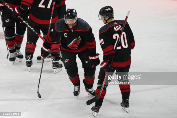 Carolina Hurricanes right wing Justin Williams celebrates with Carolina Hurricanes center Sebastian Aho after scoring the game winning goal during a...
